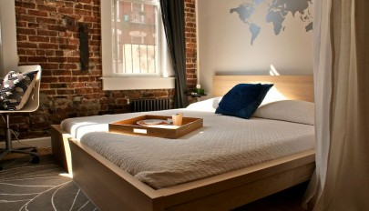 modern-bedroom-with-exposed-brick-wall