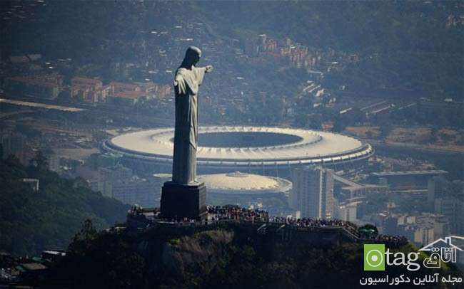 FBL-BRAZIL-WC2014-MARACANA-CHRIST...Aerial view of the Christ the Redeemer statue atop Corcovado Hill and the Mario Filho (Maracana) stadium in Rio de Janeiro, Brazil on May 10, 2013. The Maracana stadium will host the upcomig Confederations Cup next June, the Brazil 2014 FIFA World Cup and the 2016 Summer Olympics. AFP PHOTO /VANDERLEI ALMEIDA (Photo credit should read VANDERLEI ALMEIDA/AFP/Getty Images)