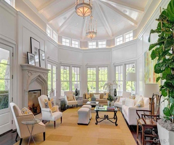 scott-mansion-living-room-ideas-with-high-ceiling-supplemented-by-white-sofa-set-a-glass-coffee-table-a-wooden-armchair-a-classic-fireplace-and-two-elegant-pendant-lights