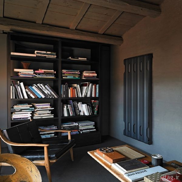 sleek-aluminum-radiators-in-contemporary-interior-with-simple-black-bookcase-wooden-ceiling-classic-armchair-also-wooden-table