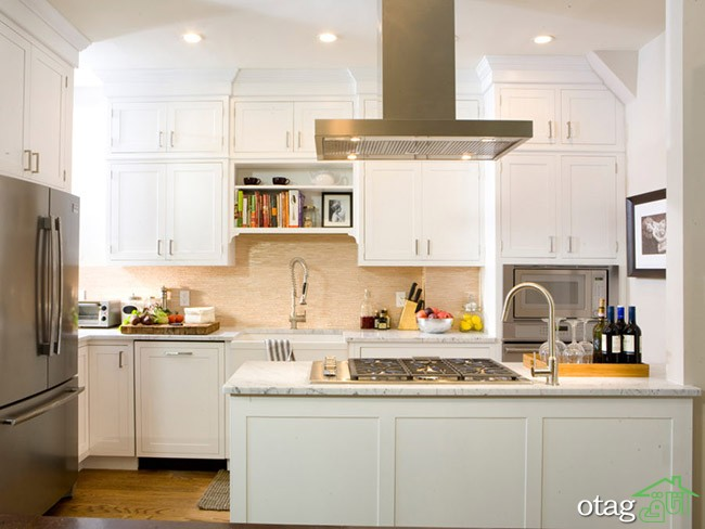 As seen on HGTV's Kitchen Cousins, the Pino's kitchen with new white kitchen cabinets.